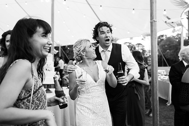 Bride surprises groom with cigar and bourbon bar and he is very pleased!  By Sarah Der