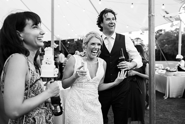 Genuine reaction after bride surprises groom with bourbon and cigar bar at wedding reception  By Sarah Der