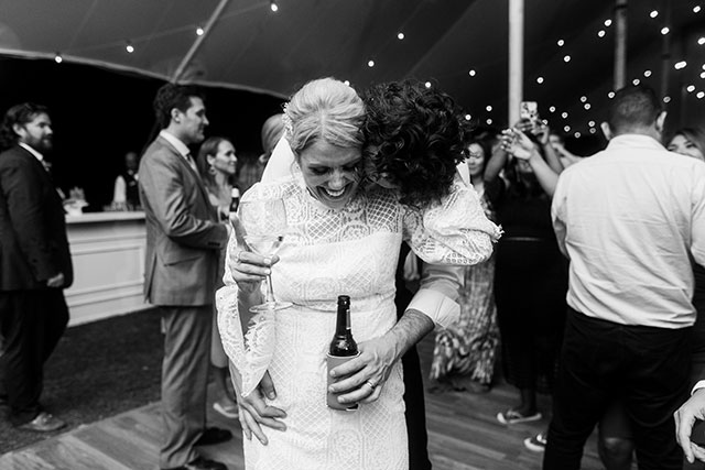 Reception photo of bride and groom dancing and super cute reception dress  By Sarah Der