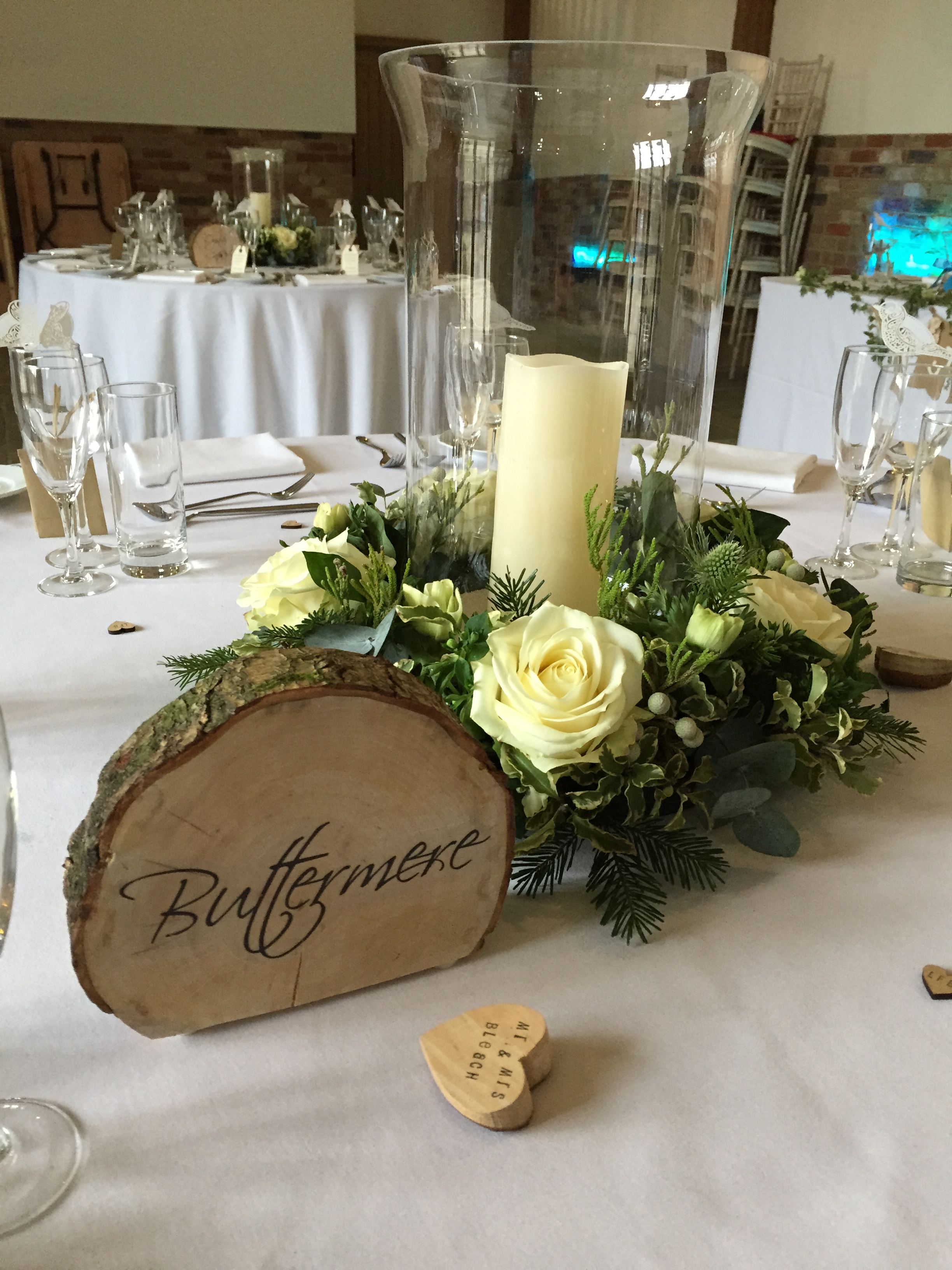 Our log slices can be personalised for your day.  We let you hire the slices and personalise with your name. If interested please  get in touch . The flowers shown were created by the talented Emma from  Wild & Green Florists.