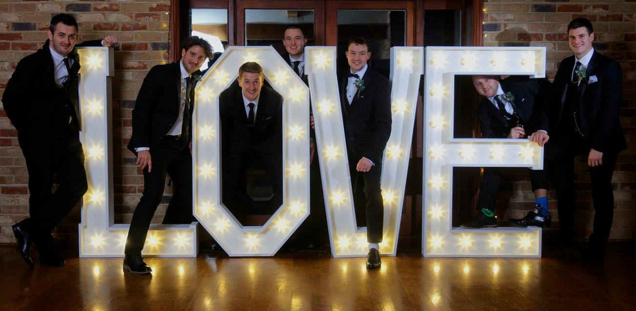 Groomsmen having fun with our love letters at  Long Furlong Barn