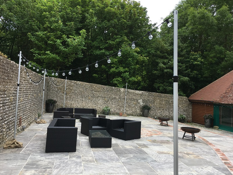 The patio by the bar dressed with our freestanding festoon poles for a festival look! We only wish we could have got a picture at night!