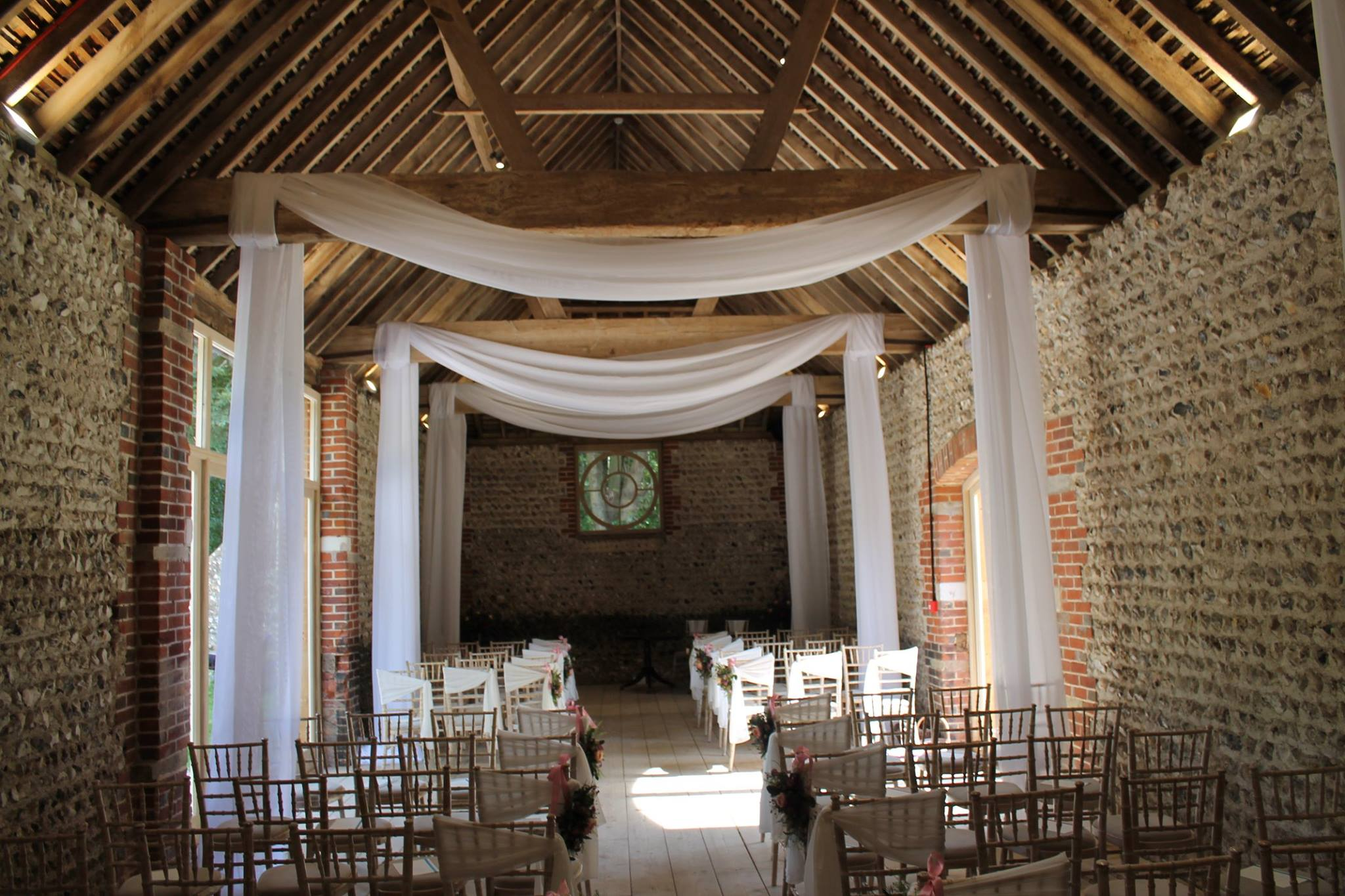 ceremony white drapes.jpg