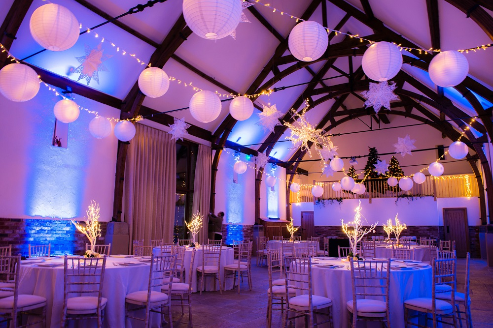 Stunning lanterns and Christmas stars at  Long Furlong Barn ,  Manzanita Trees  and lots of fairy lights for sparkle. Christmas Trees provided by venue. Photo credit Jenny Rutterford.