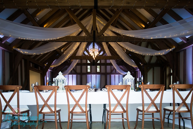 Our drapes and rustic chandelier at  Brookfield Barn . Photo credit  Love Heart Photography