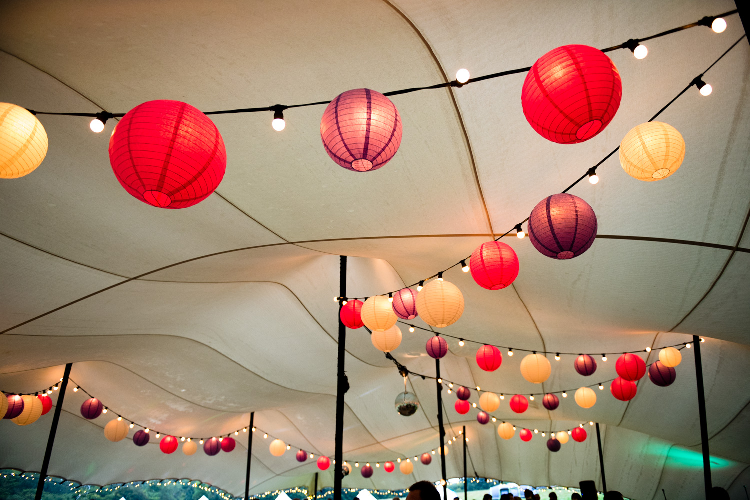Add a party vibe - Festoon lights look great with hanging lanterns and are a great source of lighting in an outdoor structure.