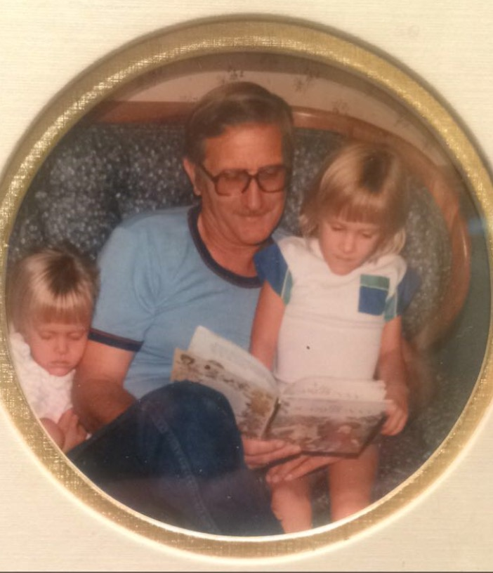 Grandpa reading to me and my older sister. I was obviously super into it.