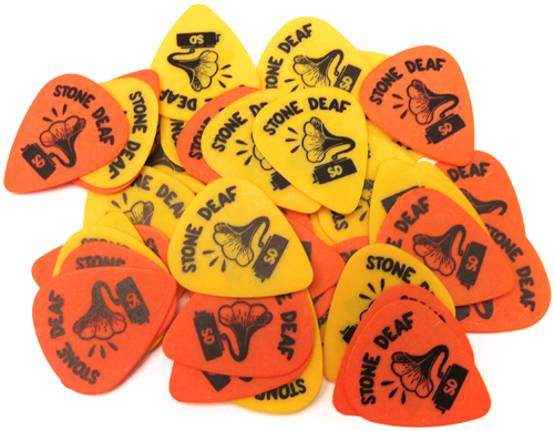 I've done design for this wicked english music brand called  StoneDeaf  started with plectrums , I call them mc-trums , they're going to be on sell very soon , I use the orange one they go well with my casual rocker looks , feel like getting naked right now .