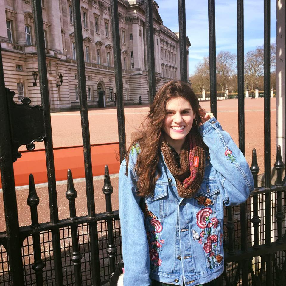 All smiles in front of Buckingham Palace.