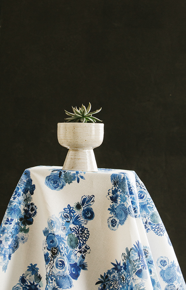 Flora in 'Casbah Blue' fabric with a simple back backdrop.