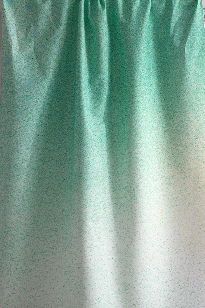 Try using atmospheric  Heavens fabric in colorway Sea Spray  to create an airy room with beachy undertones.