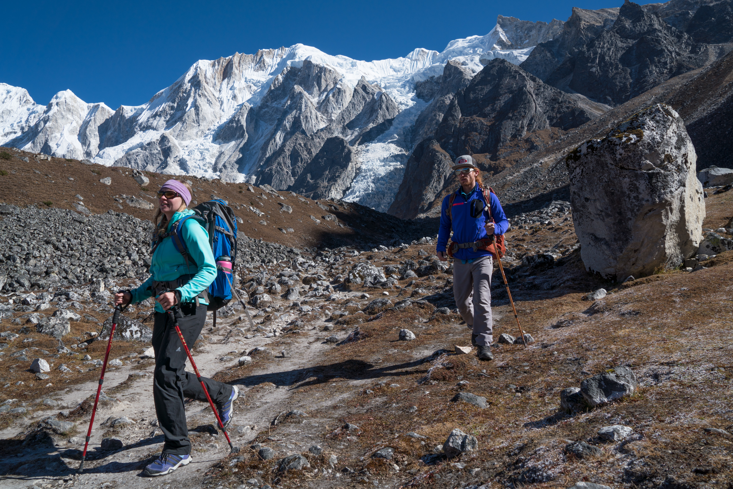 Production manager Cherise Tuttle and director Scott Rogers make their way over 5,200 meter Larke Pass. photo: cody tuttle