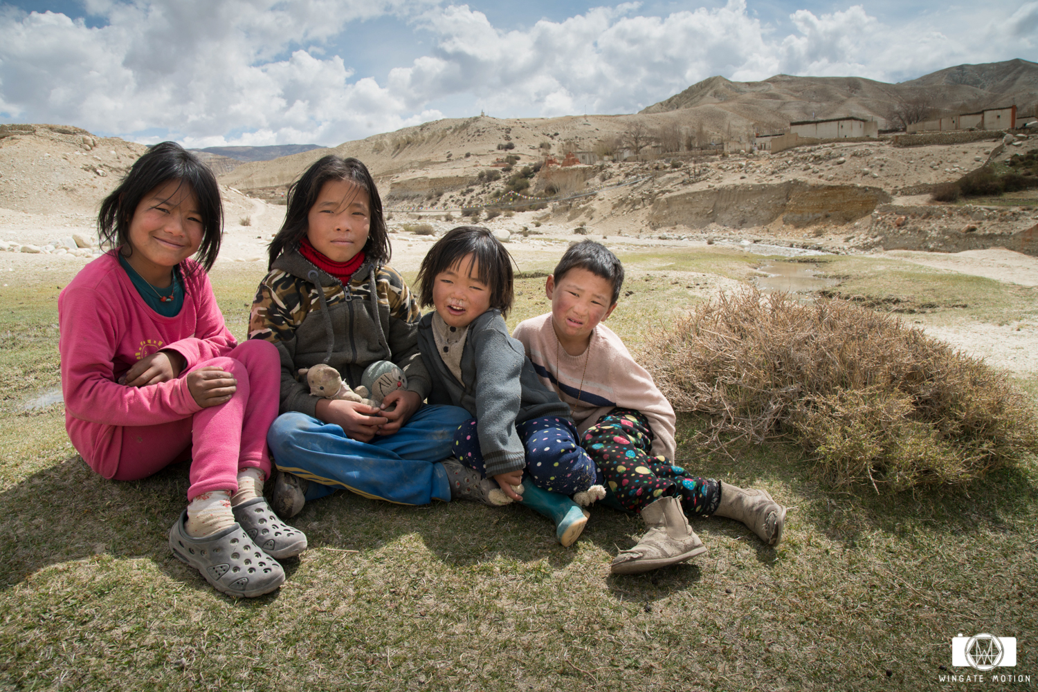 These young kids met us after landing in Lo Manthang. Interested in our paragliders they also came offering us their lunch. Nick had a portable printer that he used to give each kid a portrait. Photo: Nick Greece