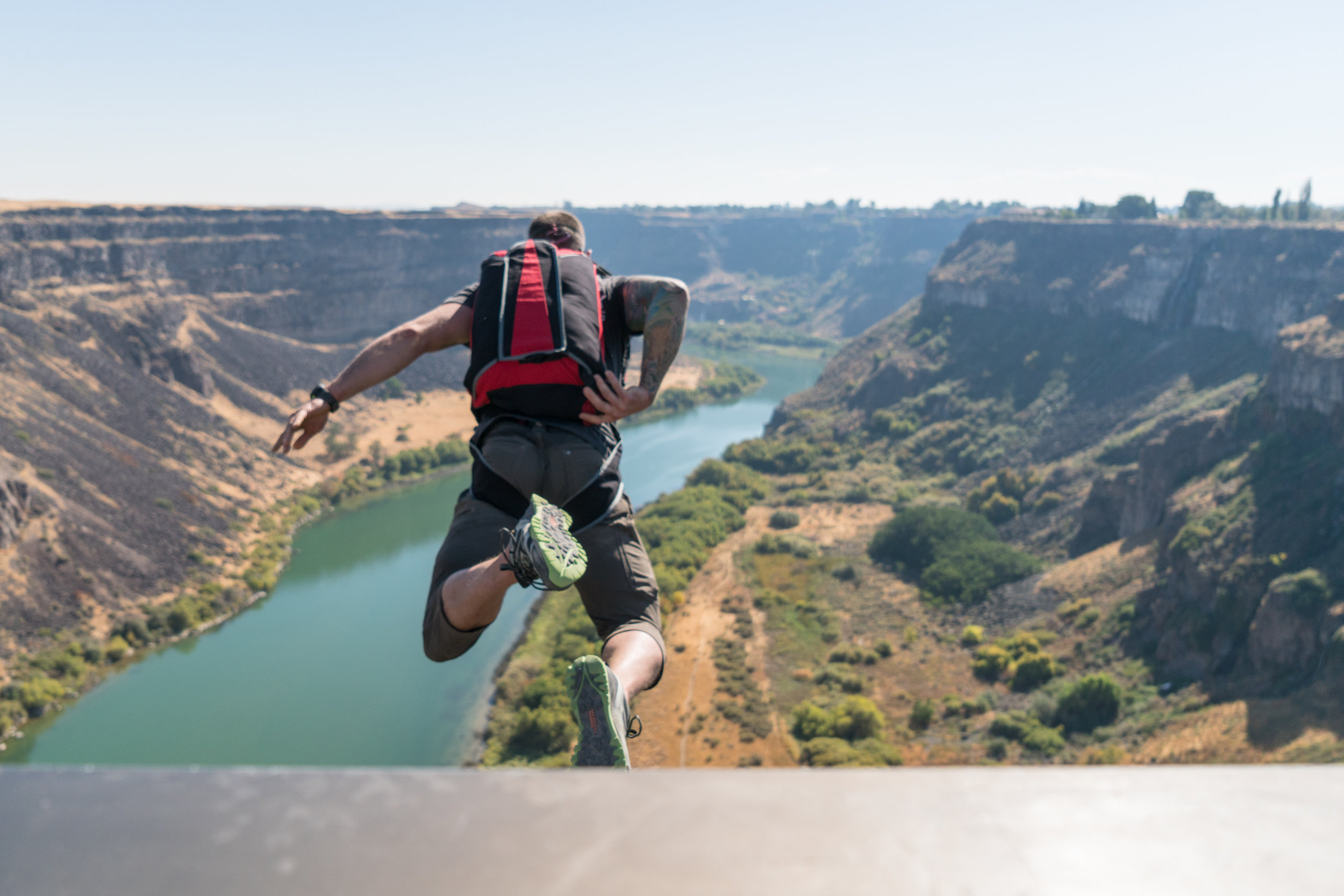 Danny leaping off the railing of the Perrine Bridge, with the Snake River 486 feet below. Photo by Scott Rogers