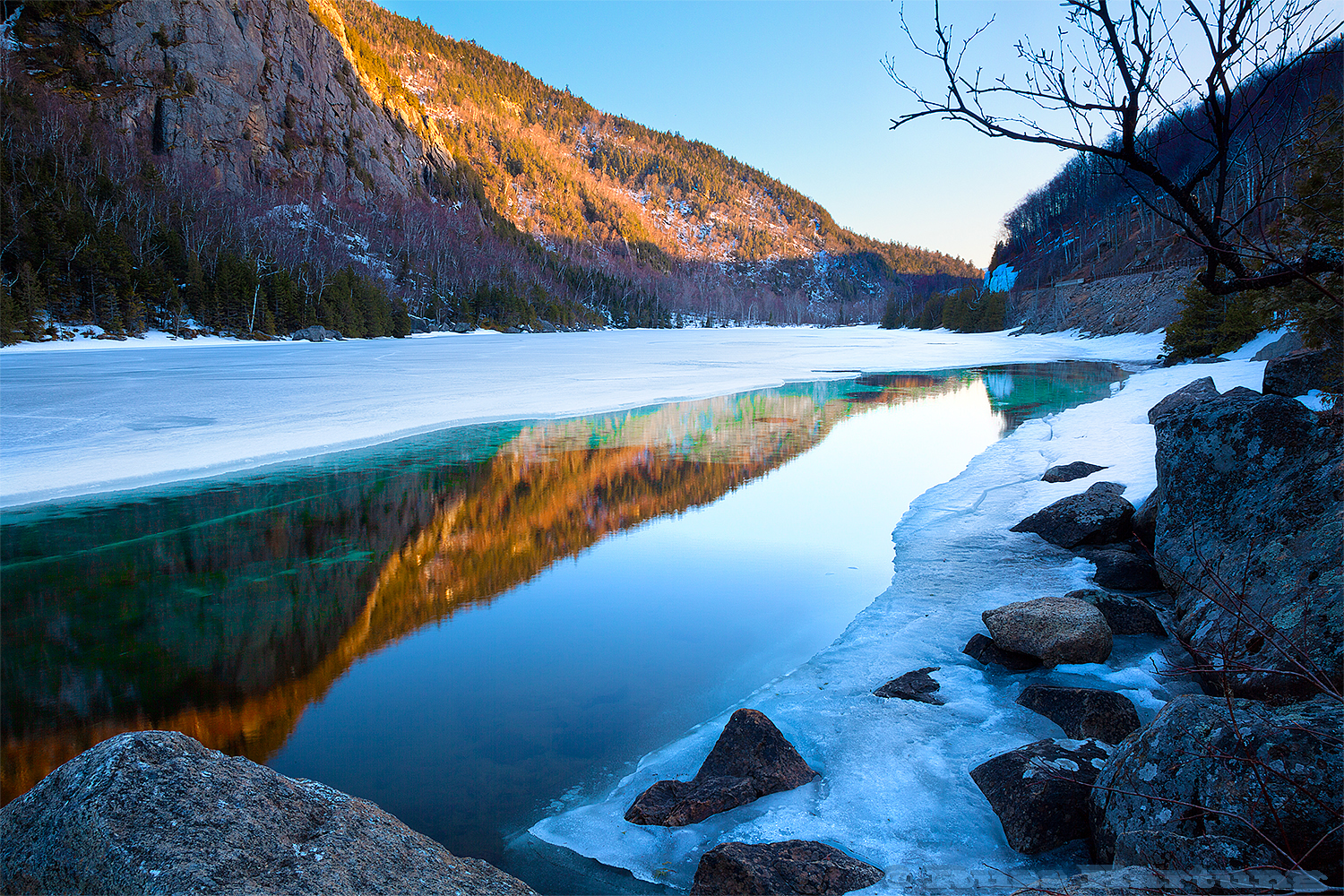 As Cascade Lake melted in the Spring, the ice under the surface of the water took on a turquoise-green hue that set off the warm glow of the late sun on the mountains.