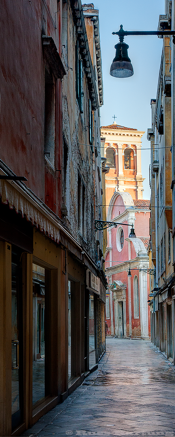One of the many narrow streets in Venice, Italy in the early morning before the tourists were up.