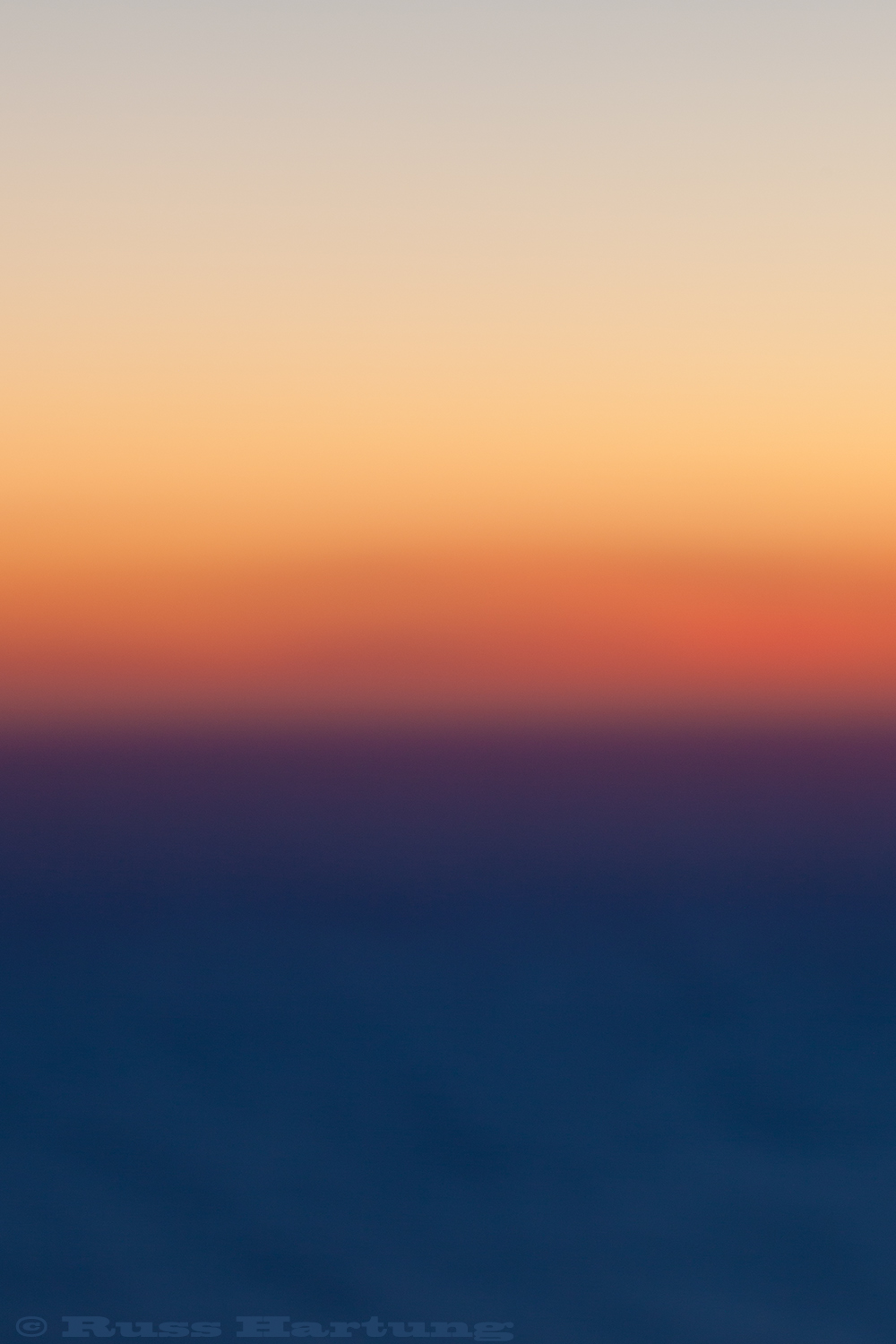 Unfocused sunset over the ocean.