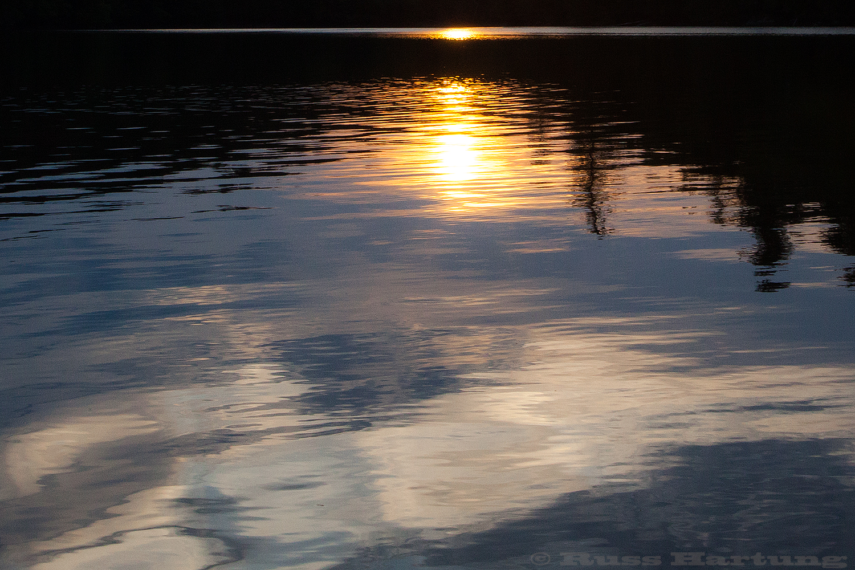 Sunset reflecting in the wake of my kayak.