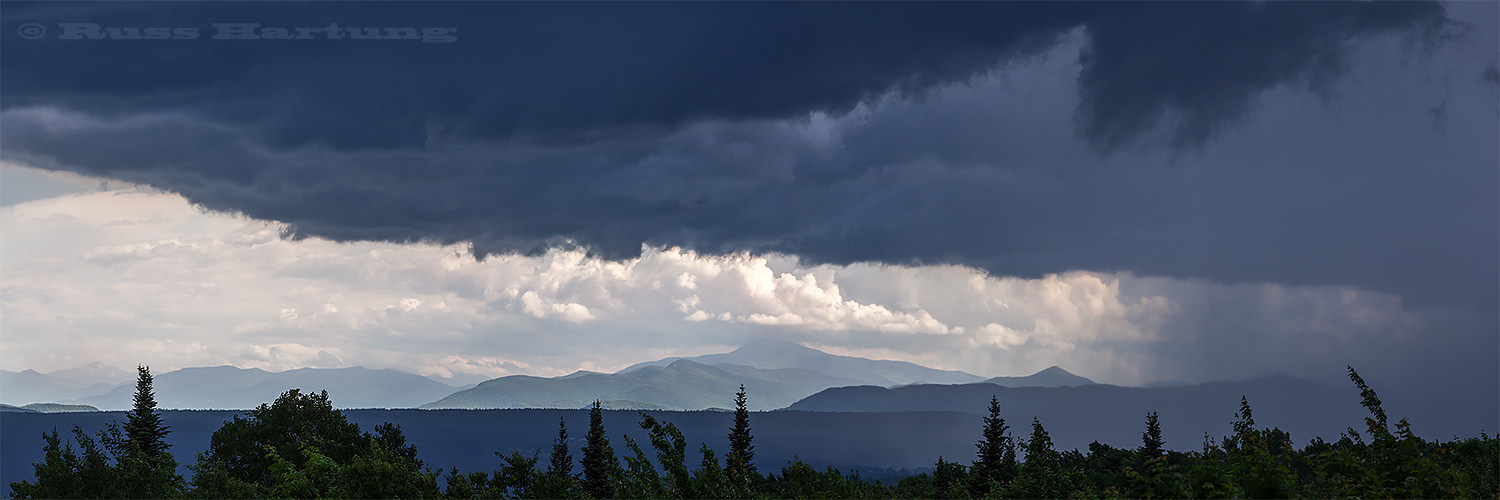 A storm moving in from the West over the High Peaks from the North.