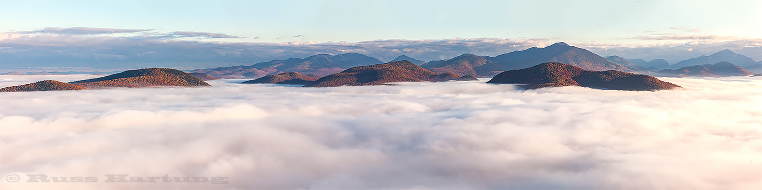 A cloud inversion settles between the mountains in the High Peaks Wilderness. View from the south.