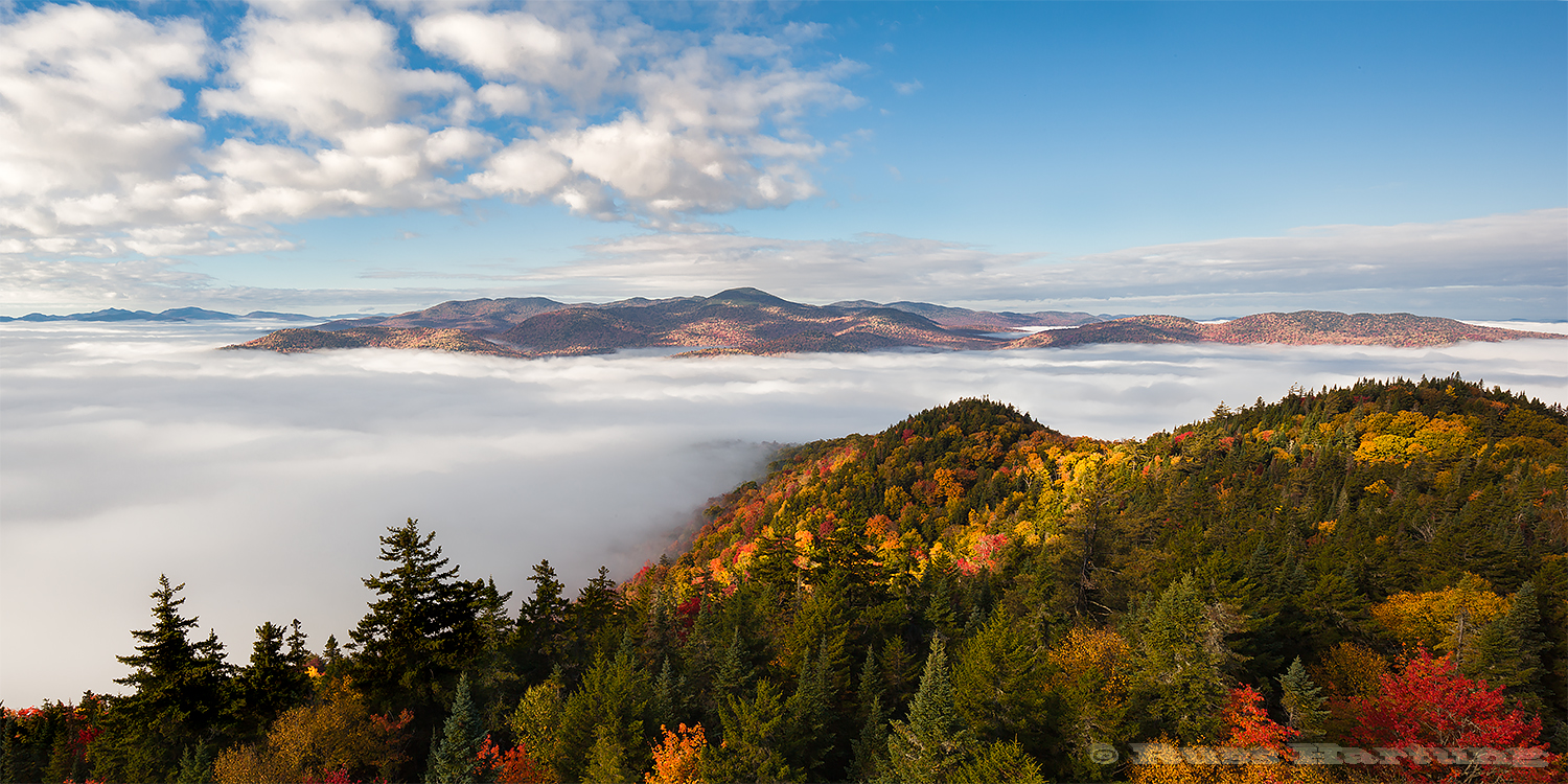 View from the Goodnow Mountain fire tower at peak foliage season. Getting here for sunrise required paddling across Cheney Pond from my campsite, through that thick fog - by compass (in the dark).