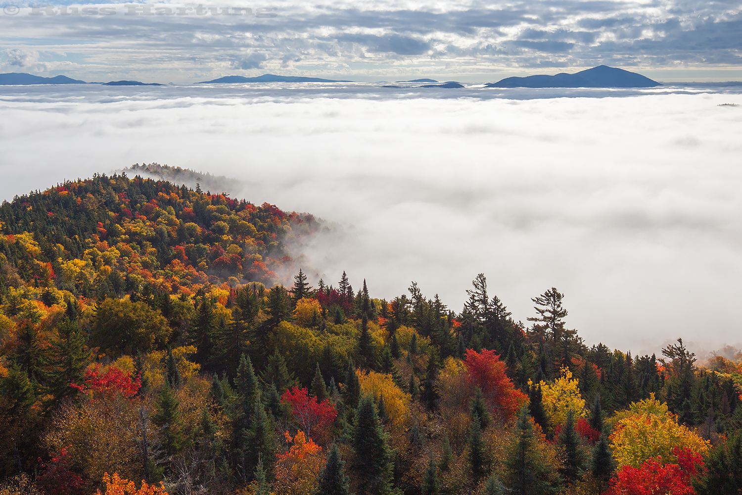 Looking east from the Goodnow Mountain fire tower over a cloud inversion in the early morning.