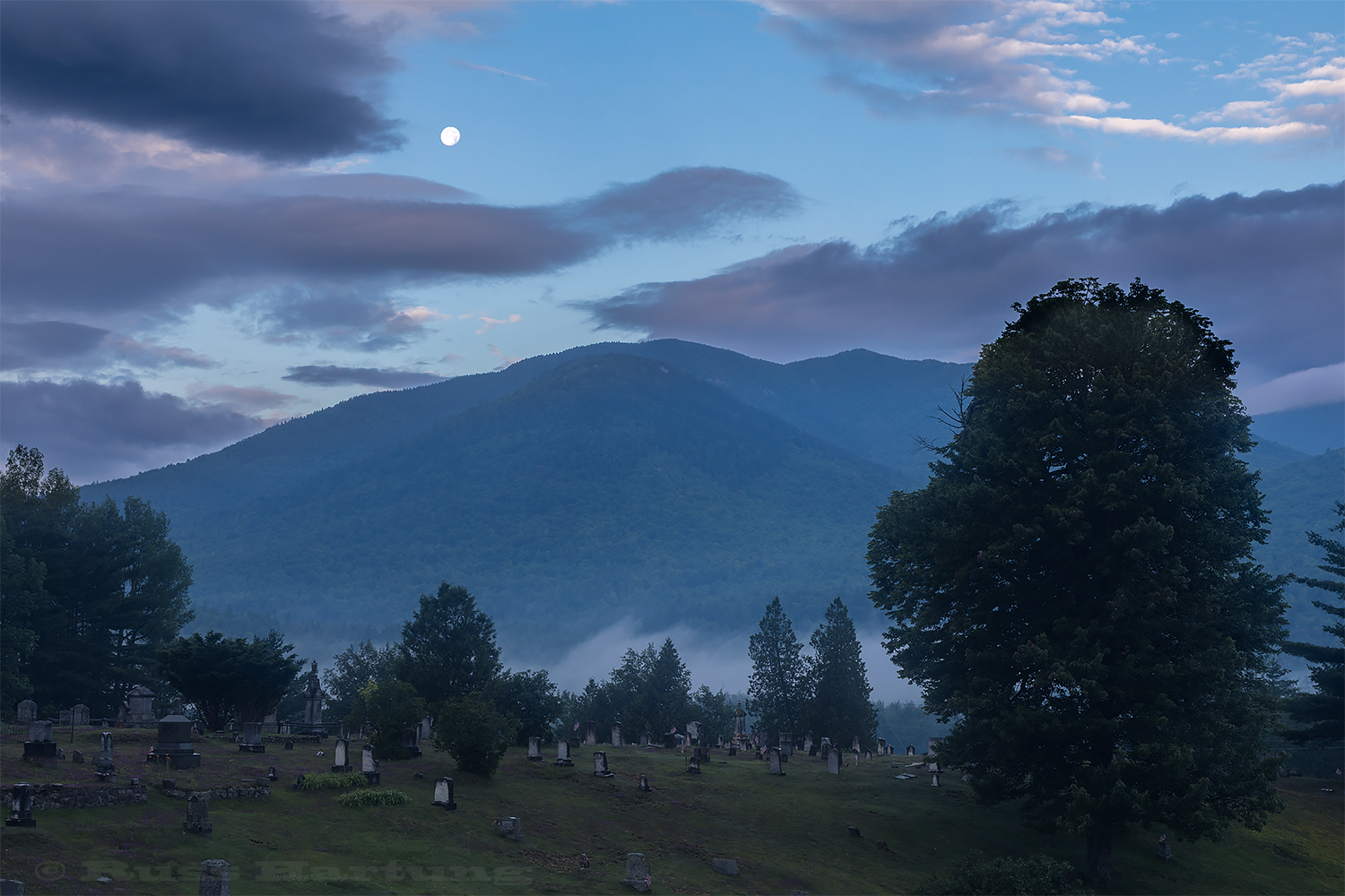 Moonset over Porter and Cascade from the cemetery in Keene.