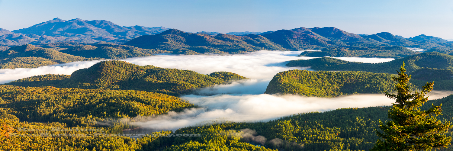 Cloud inversion settles into the valleys around Pharoah Mountain.
