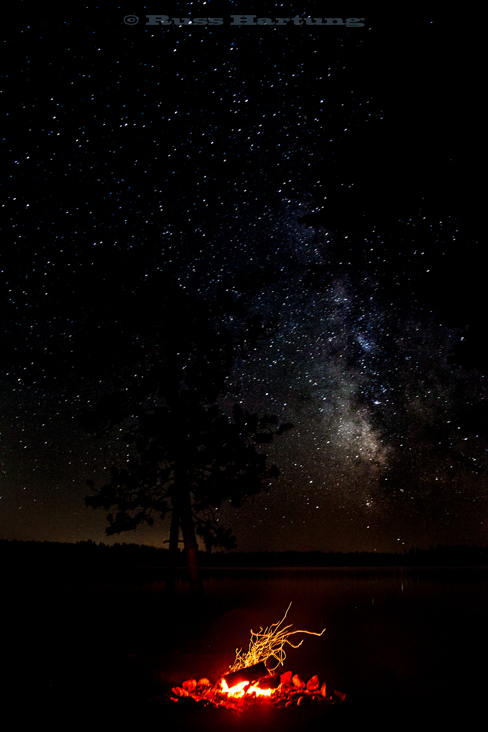 Milky Way and campfire. Wilderness campsite on Lake Kushaqua. It doesn't get any better!