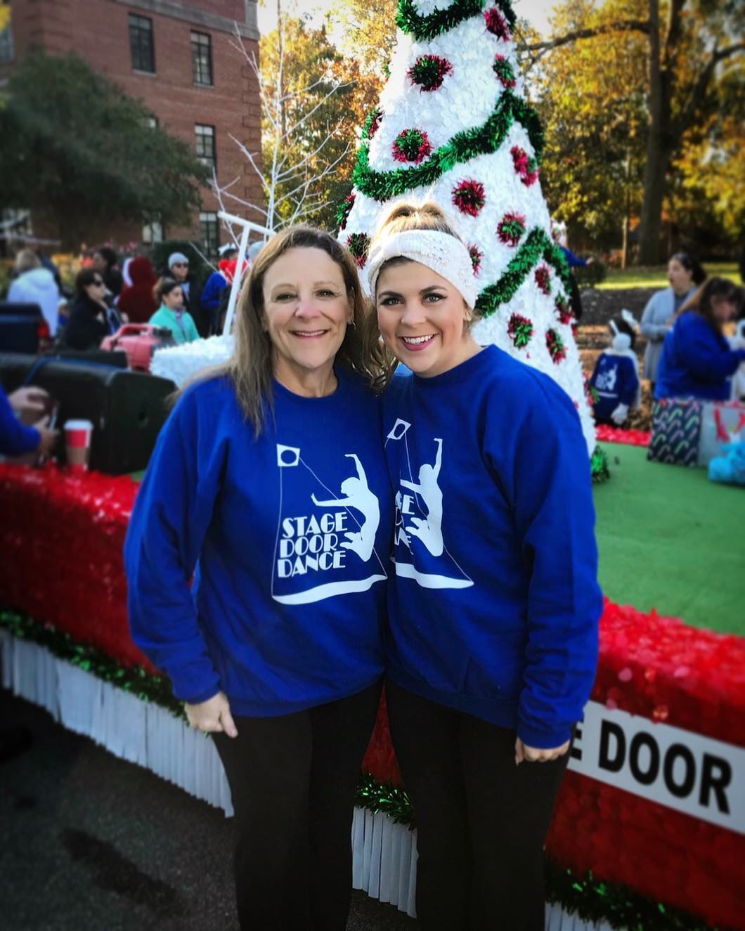 Miss Christina - Miss Christina (pictured here with her mom at the 2018 Raleigh Christmas Parade) has been a part of Stage Door Dance since 2014. A graduate of NC State University, she is currently pursuing graduate studies in addition to teaching at SDD.In her free time, Christina enjoys cheering on the Wolfpack, spending time with her pup Lilly, and traveling.