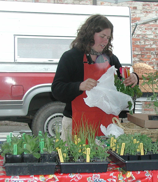 Farmer, Kate Dean, vending downtown Port Townsend in the early days of our market.
