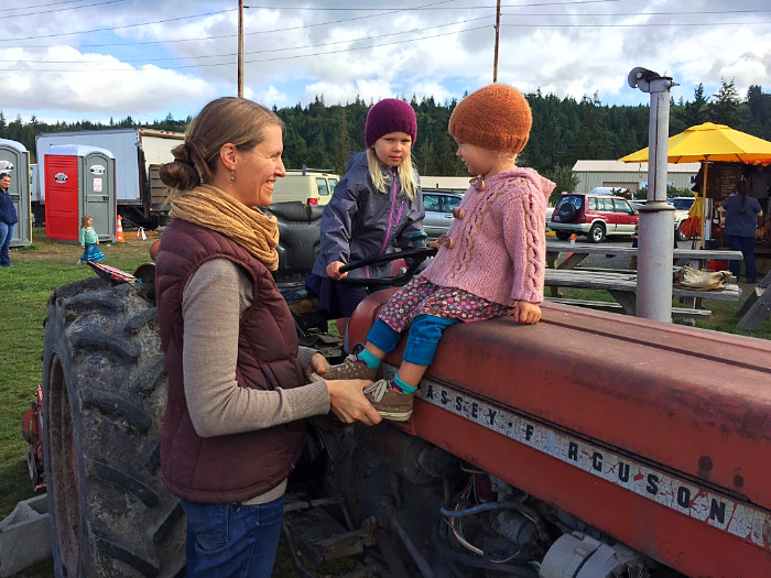 Kids sit on Red Dog tractor at the Chimacum Farmers Market