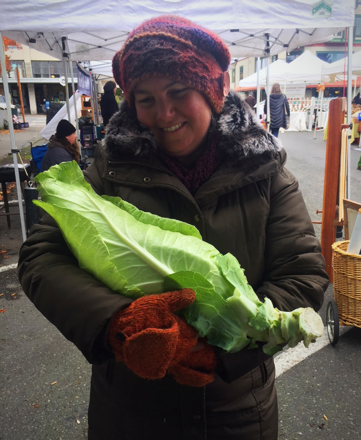 Time for some winter veggie lovin'. Assistant Market Manager, Amy Goetz, rocks her beloved cabbage from Onatrue Farm.