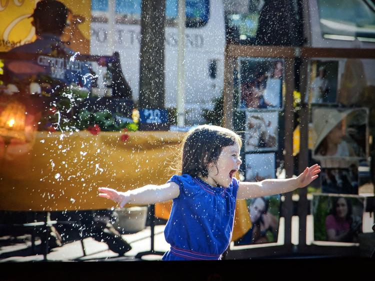 Inez Milholland playas in bubbles at the Port Townsend Wednesday Farmers Market. Photo by A Fare Story.