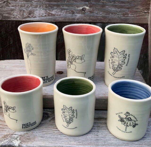 A new batch of beautiful Millbrook Clayworks Jefferson County Farmers Market cups will be available for sale at the farmers market info booth starting this Saturday. Come check them out. They are each hand-made with a vibrant colored glaze inside and a farmers market decal on the outside. $16 for a small cup and $19 for a large cup. Get yours while supplies last.