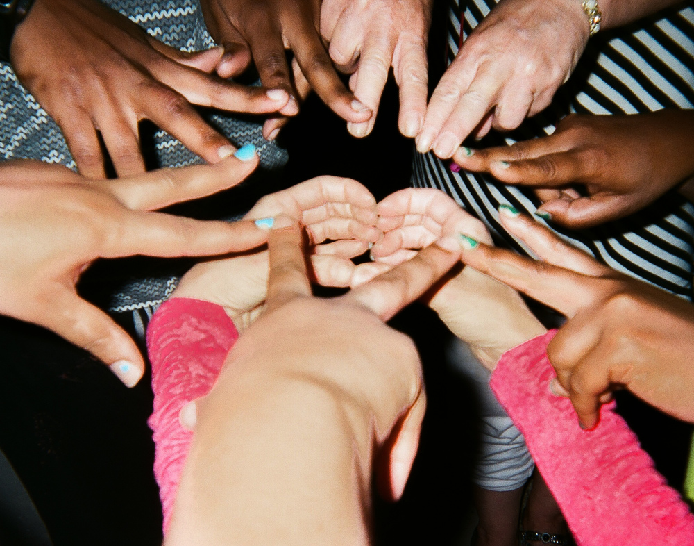 """The Love is Good  by Annette Barnett   """"We had a prayer time out back at the mission one night and I came up with the idea for the photo. We are all family here. I don't see colors or nationalities; we are all equal. And the love. The love is good."""""""