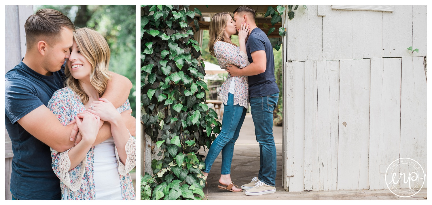 Couple posing in a leaf doorway at Myrtle Creek, kissing and snuggling close together.