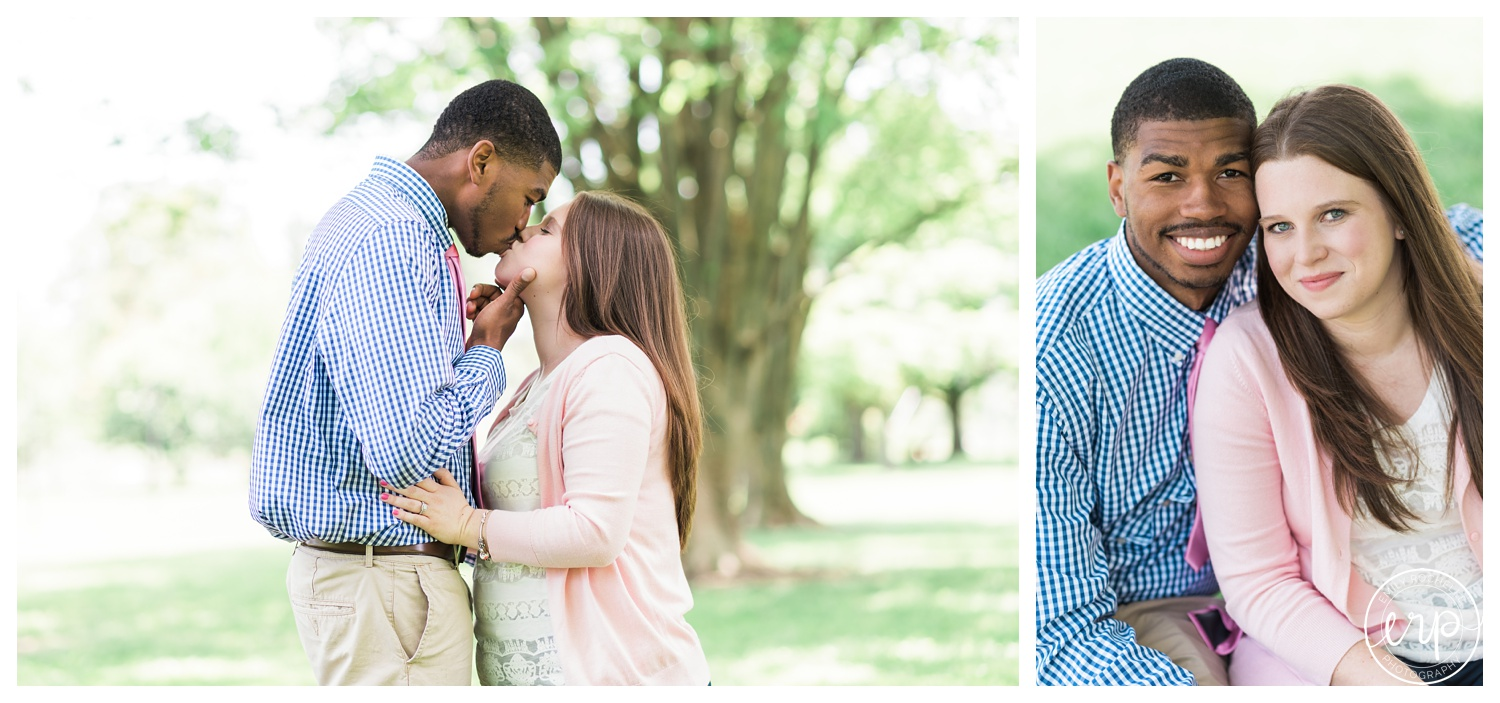 Couple kissing in the park at Cox Arboretum.