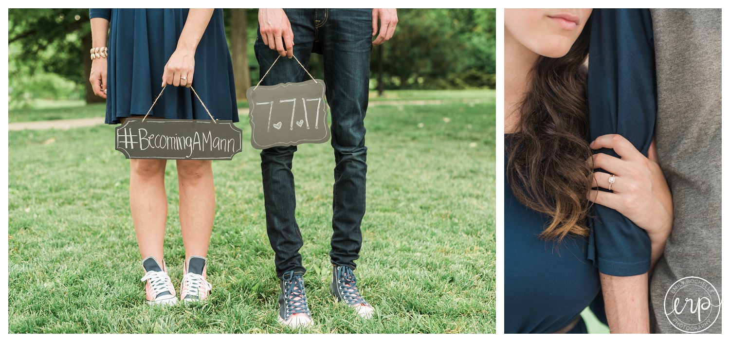 Couple holding their wedding hashtag sign with matching chucks.