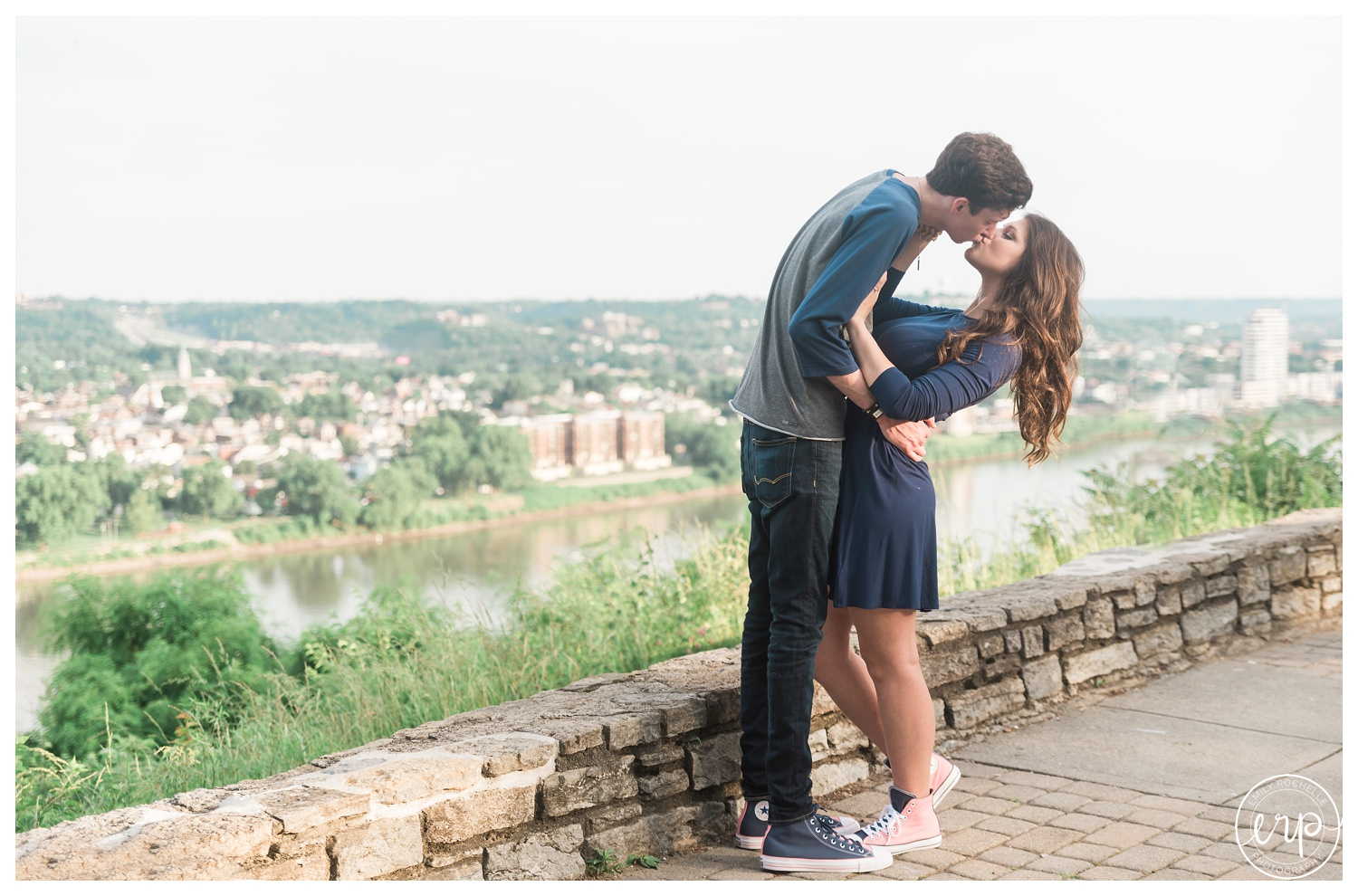 Couple dipping in front of the cincinnati skyline.