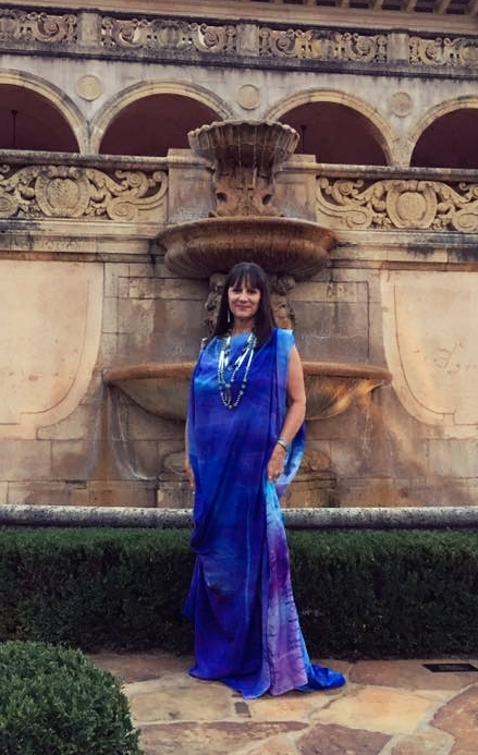 The artist in one of her designs, hand dyed and silkscreen printed silk.