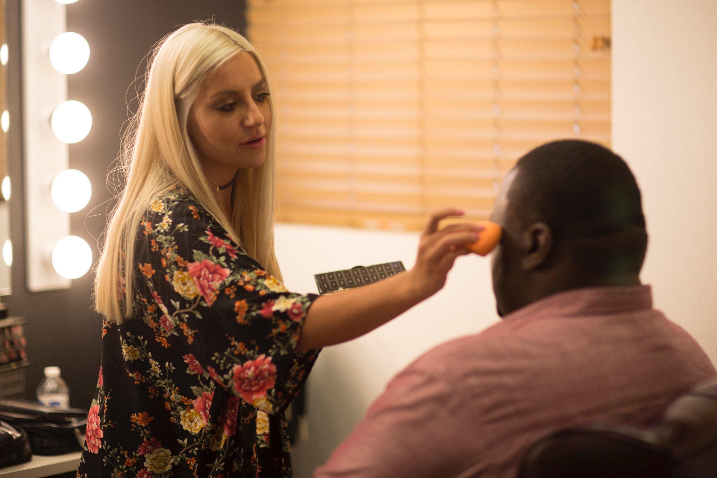 Professional makeup training on celebrity Quinton Aaron.