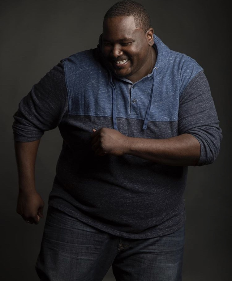 Action shot of Quinton Aaron makeup by Betty Rose.