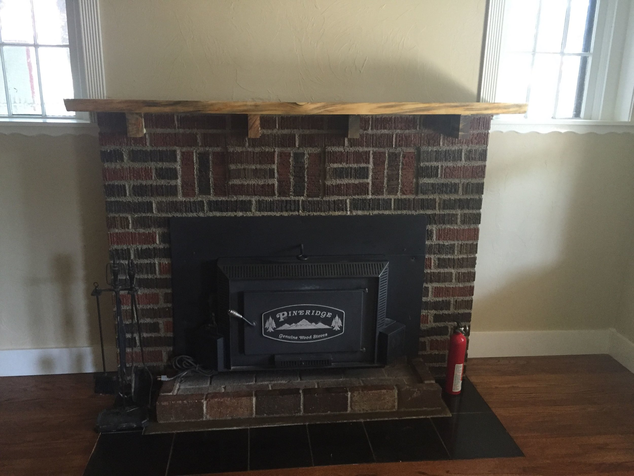 This is the wood stove in our living room. Our furnace had to be relocated to accommodate the addition upstairs, so this little thing has been keeping us warm!