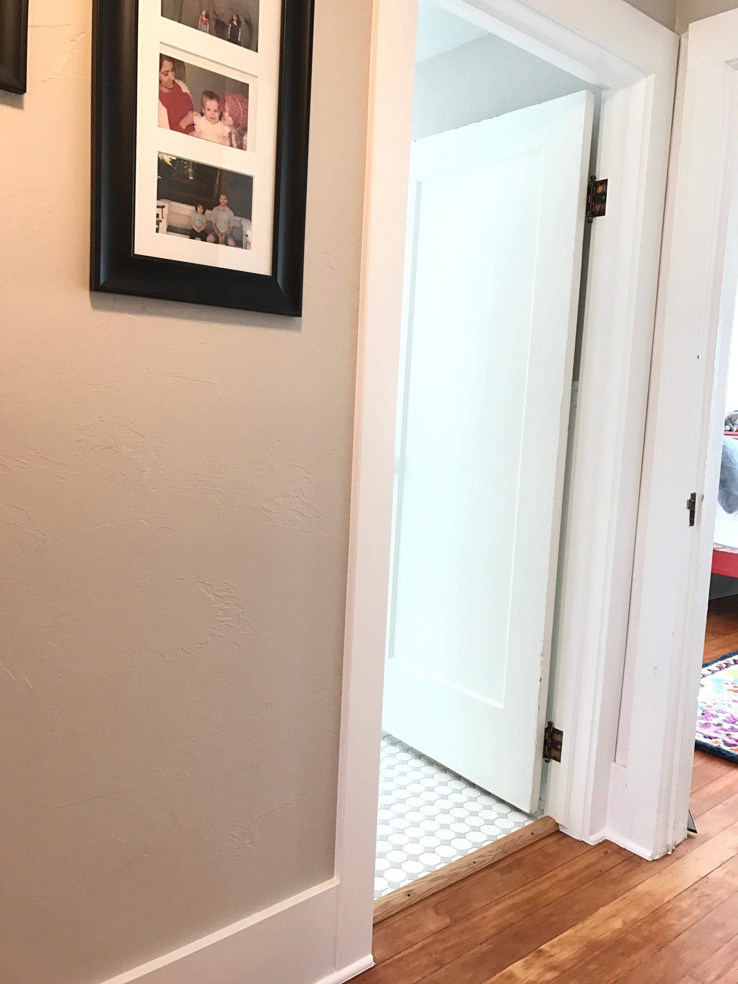Hallway to bath after.JPG