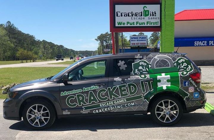 Cracked it! Escape Games partial vehicle wrap by  910 Sign Company . Partial wraps are a great way to get the message out there while keeping cost down. Graphics work to match with paint for a custom graphic at an affordable price