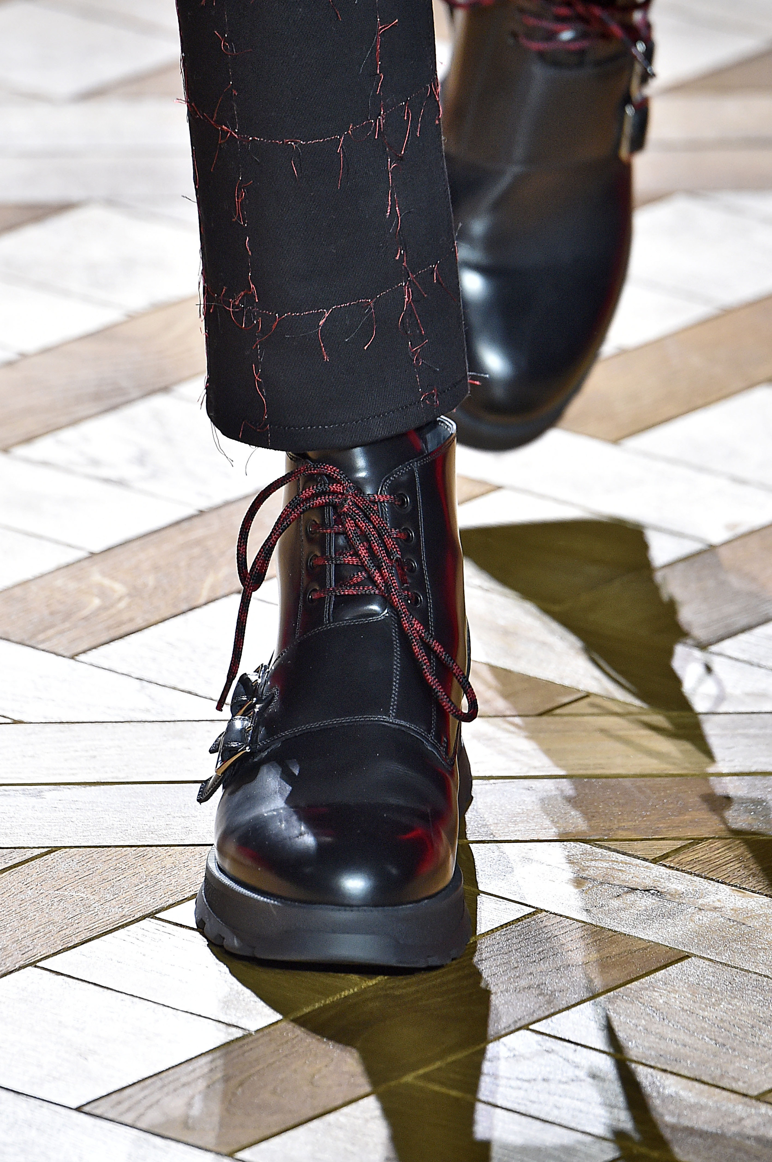 Heavy, leather military boots against the geometric, light hardwood floors bring textures and styles together to a whole new level.  Photo: Architectural Digest