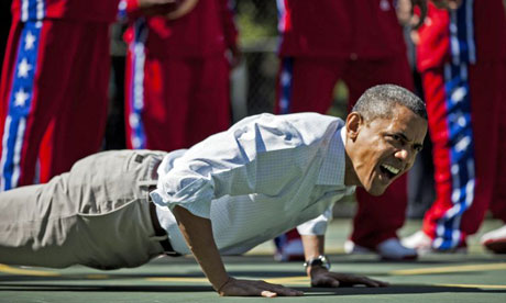 Barack Obama Doing a pretty tidy rep on the push up- slight lumbo-sacral sag but we will let Mr Commander In Chief of the USA off.