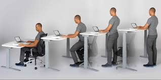 Image of man working with an adjustable desk