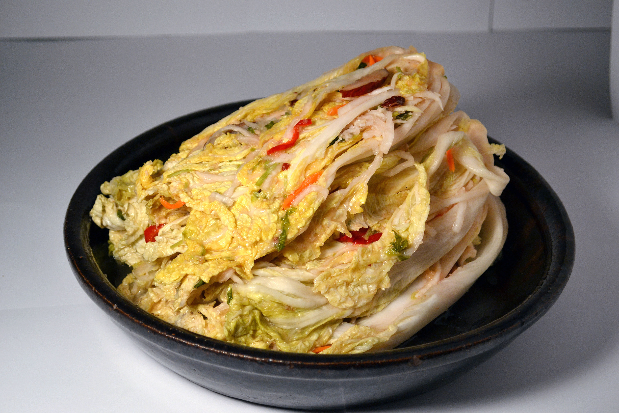 WHITE KIMCHI:This is a non-spicy Napa cabbage Kimchi. Not only does it contain the most ingredients, it is one the healthiest. For those who want a calming touch to their taste buds, this is for you.